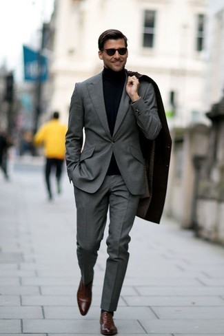 Dress in a turtleneck and a grey suit for a classic and refined silhouette. Tap into some David Gandy dapperness and complete your look with brown leather oxford shoes.