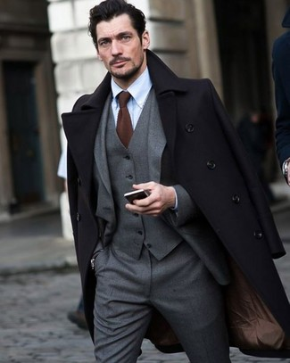How to wear: black overcoat, grey three piece suit, light blue dress shirt, brown knit tie