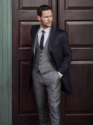 How to wear: black overcoat, grey three piece suit, white dress shirt, red and navy tie