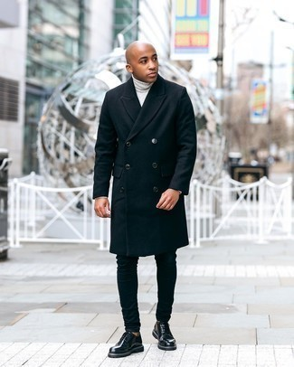 Men's Outfits 2020: A black overcoat looks so nice when married with navy skinny jeans. Black leather derby shoes will inject a sense of elegance into an otherwise straightforward look.