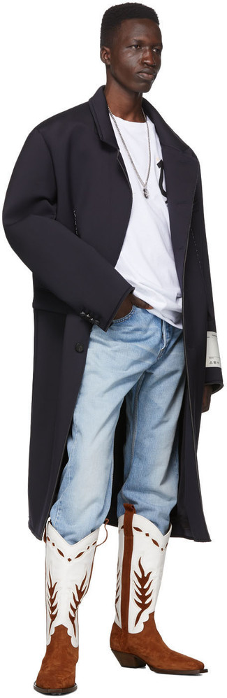 How to wear: black overcoat, white and black print crew-neck t-shirt, light blue jeans, white and brown leather cowboy boots