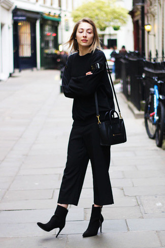 If you want to look cool and remain cosy, consider wearing a black oversized sweater and black culottes. Sporting a pair of black suede ankle boots is a simple way to add some flair to your look. And when you're having one of those gloomy fall days, sometimes only a knockout look like this one can spice it up.
