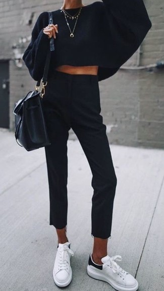 How to wear: black knit oversized sweater, black dress pants, white leather low top sneakers, black leather bucket bag