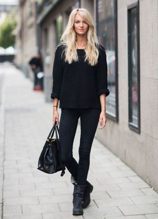 How to wear: black oversized sweater, black skinny jeans, black suede ankle boots, black leather tote bag