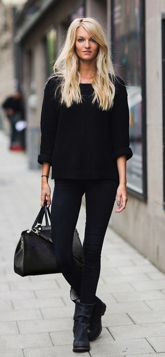 Stay stylish on busy days in an oversized sweater and black skinny jeans. Take a classic approach with the footwear and throw in a pair of black leather mid-calf boots.
