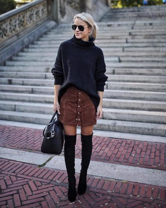 Opt for comfort in a black knit oversized sweater and a button skirt. Add black suede over the knee boots to your look for an instant style upgrade. A neat getup that will take you from summer to fall like this one makes it so easy to embrace the new season.