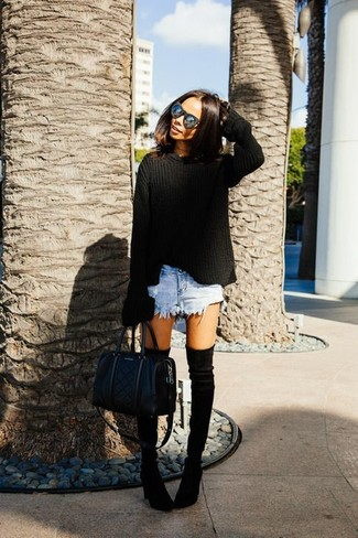 A black oversized sweater and light blue denim shorts are great essentials to incorporate into your current wardrobe. Take a classic approach with the footwear and rock a pair of black suede over the knee boots.