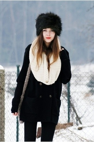 How to wear: black pea coat, black skinny jeans, black fur hat, beige knit scarf