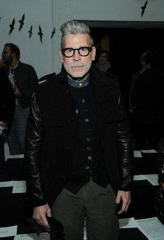 Nick Wooster wearing Black Pea Coat, Black Knit Waistcoat, Navy Chambray Dress Shirt, Dark Green Cargo Pants