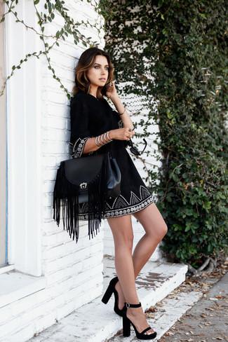 How to wear: black embroidered peasant dress, black suede heeled sandals, black fringe leather satchel bag, silver bracelet