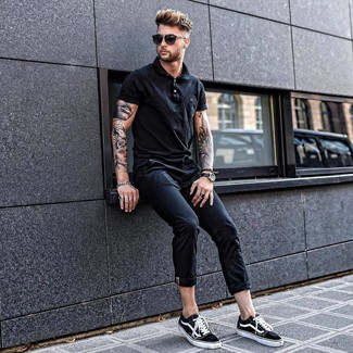 How to wear: black polo, black chinos, black and white canvas low top sneakers