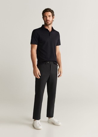 Black Polo Outfits For Men: A black polo and black chinos work together smoothly. As for footwear, complete this outfit with white leather low top sneakers.