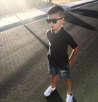 How to Wear a Black Polo For Boys: Suggest that your little angel choose a black polo and blue denim shorts for a fun day in the park. This outfit is complemented brilliantly with white sneakers.