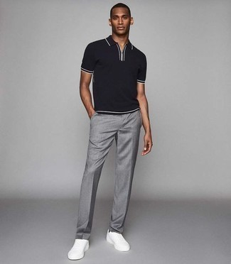 How to Wear Low Top Sneakers For Men: As you can see here, looking dapper doesn't take that much effort. Just consider teaming a black polo with grey dress pants and be sure you'll look amazing. To infuse a more casual feel into your getup, add a pair of low top sneakers to the equation.