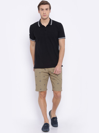 How to wear: black polo, tan shorts, navy suede driving shoes
