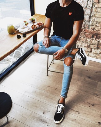 How to wear: black print crew-neck t-shirt, blue ripped skinny jeans, black and white low top sneakers