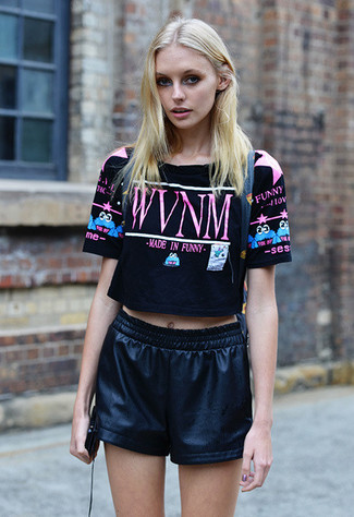 This combo of a black print cropped top and black leather shorts spells comfort and definitely sass. A great summer option, you can wear this ensemble all season long.