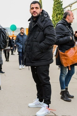 How to Wear a Black Puffer Jacket For Men: A black puffer jacket and black chinos are absolute staples if you're putting together a semi-casual closet that matches up to the highest menswear standards. Why not take a more laid-back approach with footwear and complement this ensemble with a pair of white athletic shoes?