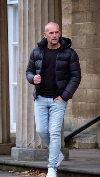 How to wear: black puffer jacket, black crew-neck t-shirt, light blue skinny jeans, white low top sneakers