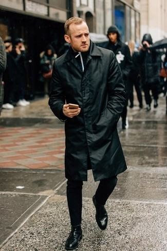 How to Wear a Black Raincoat For Men: This pairing of a black raincoat and black chinos is proof that a pared down casual look doesn't have to be boring. A trendy pair of black leather chelsea boots is a simple way to bring a dose of elegance to your look.