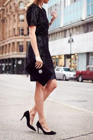 As you can see, looking stylish doesn't require that much effort. Just reach for a black sequin sheath dress and you'll look amazing. Black suede pumps are a smart choice to complement the look.