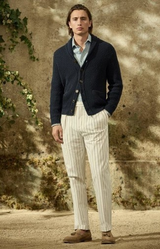 Light Blue Long Sleeve Shirt Outfits For Men: Choose a light blue long sleeve shirt and white vertical striped chinos for a casual kind of sophistication. Complete your outfit with tan suede tassel loafers for an extra touch of refinement.