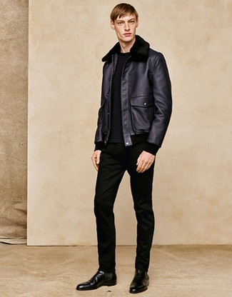 How to wear: black shearling jacket, black crew-neck sweater, black jeans, black leather chelsea boots