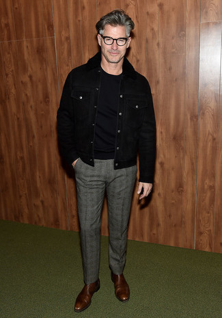 How to Wear a Black Shearling Jacket For Men: Teaming a black shearling jacket with grey plaid wool dress pants is a good option for a sharp and polished outfit. Add brown leather chelsea boots to the mix and you're all set looking smashing.