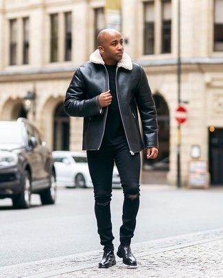 500+ Winter Outfits For Men: A black shearling jacket and black ripped jeans married together are the ideal ensemble for those who appreciate cool and casual styles. And if you want to instantly up this ensemble with a pair of shoes, why not throw a pair of black leather chelsea boots in the mix? While it can be a bit of a conundrum to look stylish on extra cold days, it's combos like this that prove it's totally possible.