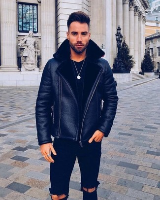 How to wear: black shearling jacket, black crew-neck t-shirt, black ripped skinny jeans