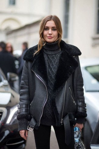 How to wear: black shearling jacket, black knit turtleneck, black skinny jeans