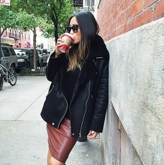 How to wear: black shearling jacket, black turtleneck, brown leather pencil skirt, black sunglasses