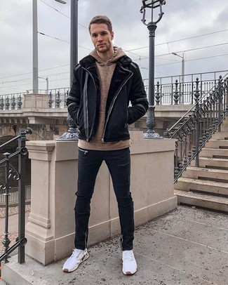 How to wear: black shearling jacket, brown hoodie, black ripped skinny jeans, white athletic shoes