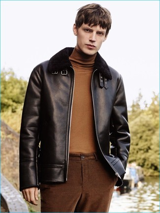 How to wear: black shearling jacket, brown turtleneck, brown chinos