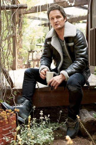 How to wear: black shearling jacket, charcoal crew-neck t-shirt, black ripped skinny jeans, black leather casual boots