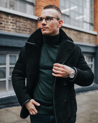 How to wear: black shearling jacket, dark green turtleneck, navy skinny jeans, silver watch
