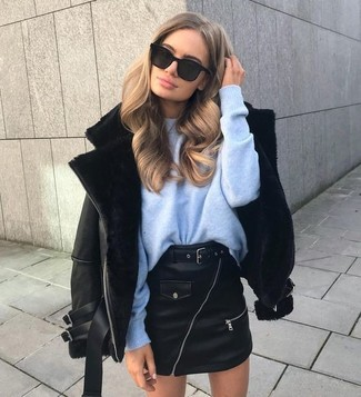 How to wear: black shearling jacket, light blue oversized sweater, black leather mini skirt, black sunglasses