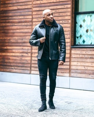500+ Winter Outfits For Men: This laid-back combination of a black shearling jacket and navy skinny jeans can only be described as ridiculously sharp. A pair of black suede chelsea boots immediately dials up the fashion factor of any look. You see here this combination is also a vivid example of how to style warm layers in the dead of winter.