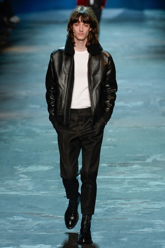 How to wear: black shearling jacket, white crew-neck t-shirt, black dress pants, black leather dress boots