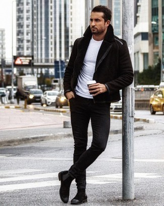 Black Jeans Winter Outfits For Men: If you're in search of an off-duty yet stylish getup, team a black shearling jacket with black jeans. Black suede chelsea boots are guaranteed to infuse an added touch of class into your outfit. You might be thinking that just because it is snowing outside you have to sacrifice your style, but it's just not true, and this look is proof.