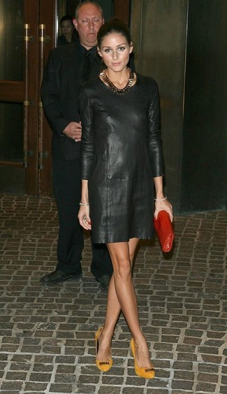 Olivia Palermo wearing Black Leather Shift Dress, Mustard Suede Pumps, Red Leather Clutch, Gold Necklace