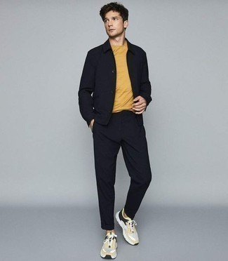 How to Wear a Mustard Crew-neck T-shirt For Men: Irrefutable proof that a mustard crew-neck t-shirt and black chinos are amazing when matched together in a casual getup. You know how to tone down this look: yellow athletic shoes.