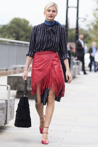 Effortlessly blurring the line between chic and casual, this combination of a black vertical striped shirtdress and a red leather mini skirt is likely to become one of your favorites.