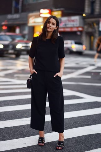 Try teaming a black short sleeve blouse with black culottes to effortlessly deal with whatever this day throws at you. Bring a touch of sophistication to your outfit with black embellished leather mules. So if it's a super hot warm weather afternoon and you want to look chic without putting too much effort, this getup will do the job in no time flat.