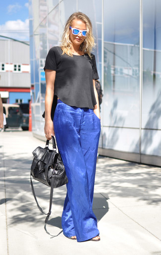 How to Wear a Black Short Sleeve Blouse: If you're planning for a fashion situation where comfort is imperative, this pairing of a black short sleeve blouse and blue wide leg pants is always a winner.