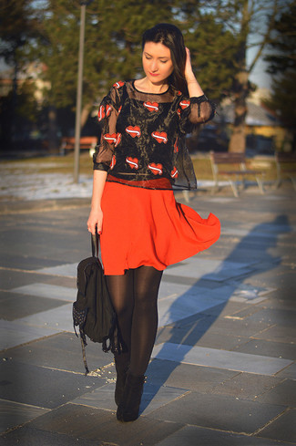 A black print short sleeve blouse and a red pleated skirt feel perfectly suited for weekend activities of all kinds. And it's a wonder what a pair of black suede ankle boots can do for the look. You can bet this combination is the answer to all of your transeasonal style woes.