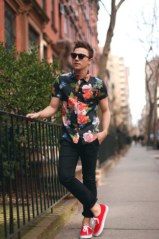 Try pairing a floral short sleeve shirt with black casual trousers for a trendy and easy going look. Round off this look with red low top sneakers.