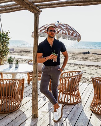How to Wear a Black Short Sleeve Shirt For Men: For an outfit that's super simple but can be manipulated in plenty of different ways, reach for a black short sleeve shirt and grey vertical striped chinos. A pair of white leather low top sneakers is a great pick to round off your outfit.