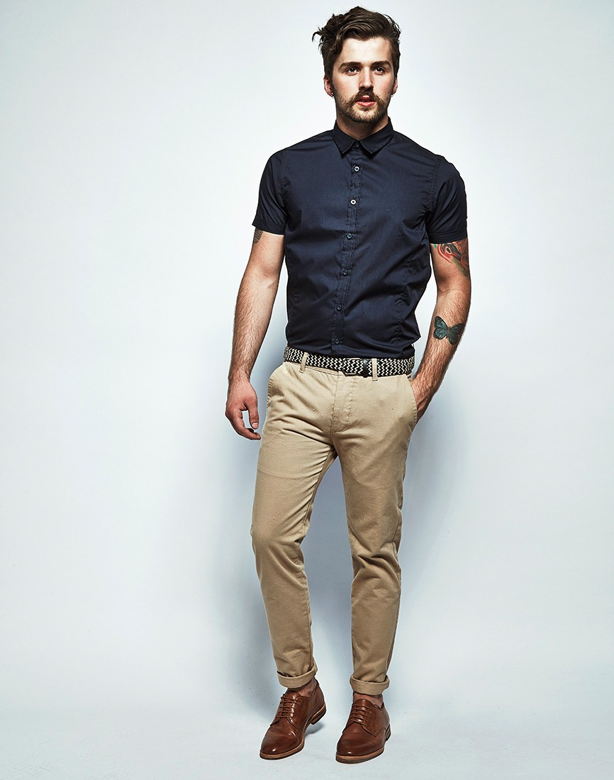 Sure, there are certain colors that you just don't pair with khaki -- a red shirt and khaki pants can quickly make you look like you're donning a sales associate uniform -- but black and khaki can present quite a beautiful look when you wear them right.