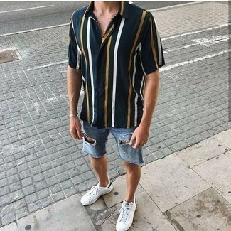 How To Wear Light Blue Denim Shorts With White Sneakers In Your 20s For Men: This combination of a black vertical striped short sleeve shirt and light blue denim shorts is the perfect foundation for an endless number of dapper outfits. Introduce a pair of white sneakers to the mix to keep the ensemble fresh.